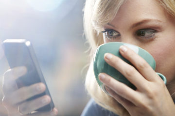 web design company-woman using phone